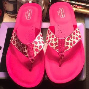 Pink and white coach slippers